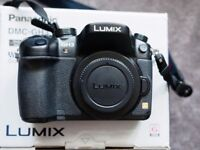 As New ! Panasonic Lumix GH3 with 14-42 lens , battery grip , flash , cross strap