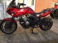 Honda CBF600 SA 2009 reg six speed four cylinder motorcycle. Genuine documented miles, in Red.