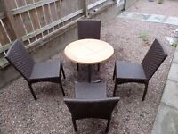 garden table and 4 chairs in great condition weather resistant