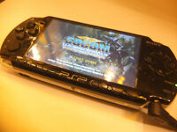Sony PSP Console, Charger, Games and Movies.