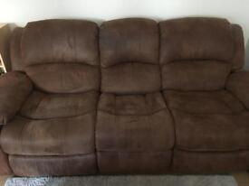 Brown sofa with reclining sections
