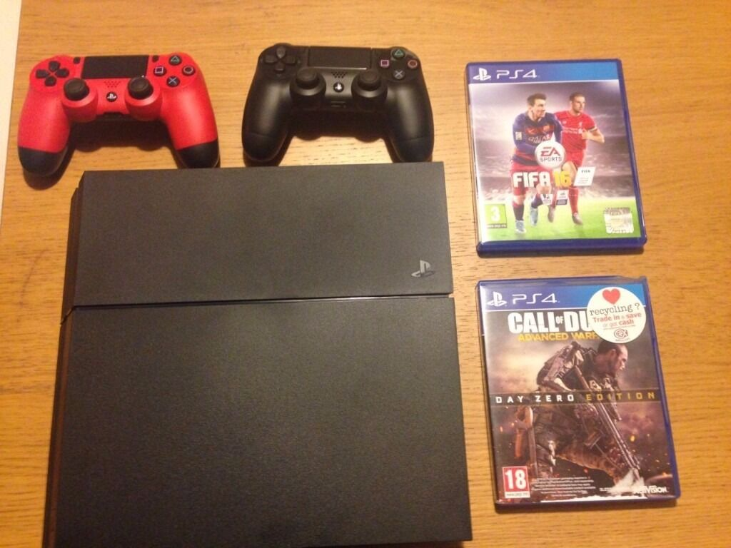 PS4 brand new (used twice) black 500Gb two games and two handsets!