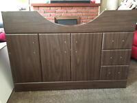 New Three door, three drawer floor standing semi counter top sink unit in dark wood effect