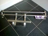 Stainless steel rails, hooks, holder. Also spice rack.