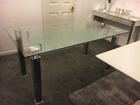 Solid glass table with chrome legs,seats 4-6