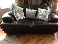 Two seater chocolate brown leather sofa in excellent condition