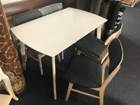 White and oak dining table and 4 grey fabric chairs
