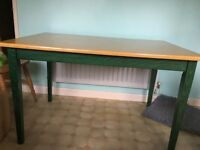 Green legged wooden kitchen table