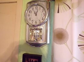 wall clock ,gold coloured with chimes