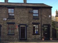2 bedroom house in Mossley with garden area and parking space. Close to train station.
