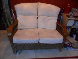 Beautiful 2x2 seater sofa's Cane in very good condition. table with glass top