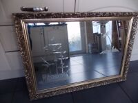 NICE LARGE GILT FRAME GLASS SCENE MIRROR.