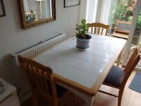 tiled pine dining table with 3 pine chairs