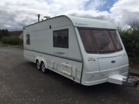 Coachman laser 590/5 berth 2003 cassette toilet shower hot and cold running water blinds fly nets