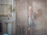 Wet room shower glass on chrome rail with shower attachment still boxed