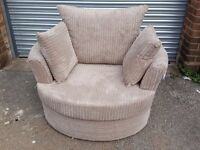 Cute light beige cord large swivel cuddle love chair. Brand new. Can deliver