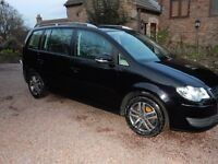 VW Black Touran. 83 000 miles. Full VW service history. MOT until July. Good condition