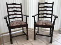 PAIR OF DARK WOOD ANTIQUE STYLE CARVER DINING CHAIRS WITH TAPESTRY STYLE SEAT