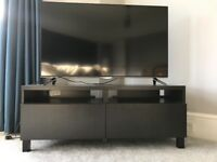 IKEA black tv unit with two push draws.