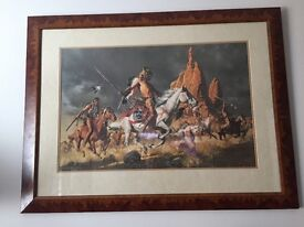 Framed picture of native Americans charging into battle . Lovely picture .