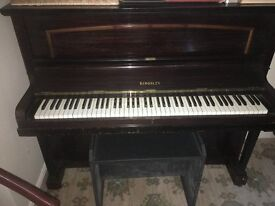Kingsley upright piano looking for a new home