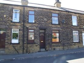 A Well Maintained Attractive Stone Built Mid Terraced House