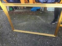 Gold coloured framed mirror