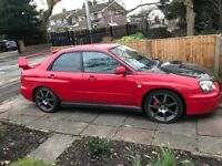 Suburbu Impreza in Red. limited number in red. Excellent car sorry to see it go. Brilliant runner