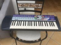 Yamaha PSR74 Electric KeyBoard, plus music books and CDs