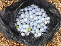 Large bag of used golf balls