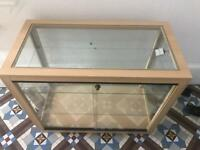 Glass display unit with light in pristine condition