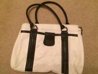 Black and white unused Oasis bag