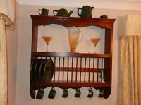 """A wooden plate rack and shelving storage, rich brown in colour measures 33"""" wide by 35"""" high"""