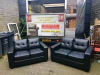 X-display 2×2 black leather 2 seater sofas