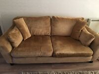 Two seater dark beige material couch