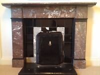Antique rouge marble fireplace surround