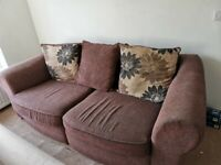 Brown sofa. Well used but lots of life left in it.