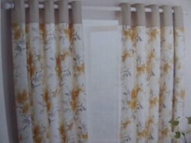 Eyelet curtains, each curtain approximately 155cm wide x 181cm long