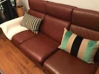 Tan leather reclining sofa