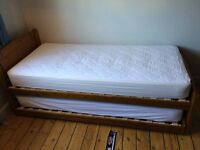 Full sized single bed with slide out guest bed