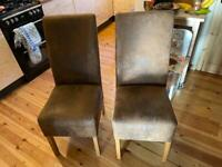 Four buffalo leather chairs