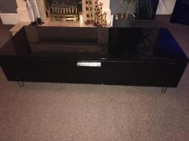 Black gloss tv unit with tempered glass