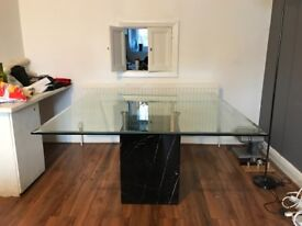 Glass dining table with black marble base