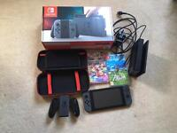 Nintendo switch with Zelda, mario kart and gameware carry case