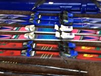 Snow skis 3pairs of snow skis and poles 2 carrying cases