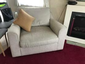 Settee and cuddle chair with foot stool.