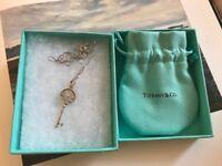 Tiffany classic daisy key necklace, never worn