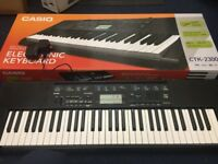 Casio CTK-2300 Electric Keyboard - 61 keys - boxed and unused + power adaptor