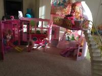 Barbie house and Barbie Wardrobe with 7 dolls