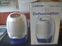 Amcor Mini Dehumidifier, w/ power supply , boxed & good working order